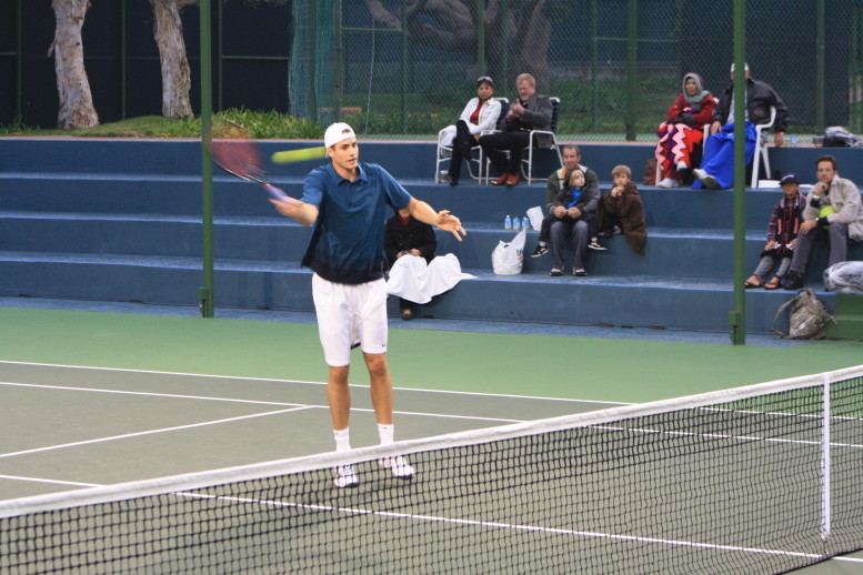 John Isner volleys at the Inagural Charity Challenge at the Manhattan Country Club